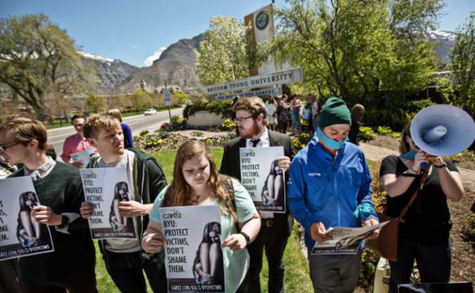 Demonstrators in Provo, Utah, last week protested Brigham Young University's use of its Honor Code to investigate and punish students who reported being sexually assaulted. Credit Kim Raff for The New York Times